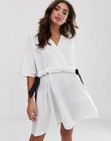 Asos Design DESIGN v front v back ruched waist mini smock dress