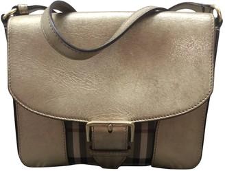 Burberry Gold Cloth Handbags