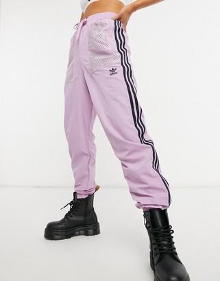 adidas mesh logo track pants in pink