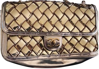 Chanel 2.55 Gold Patent leather Handbags