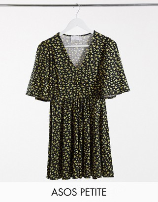 ASOS DESIGN Petite mini swing dress in black and yellow floral print