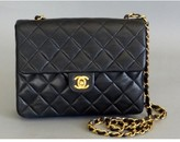 Chanel excellent (EX Navy Quilted Lambskin Mini Classic Flap Bag