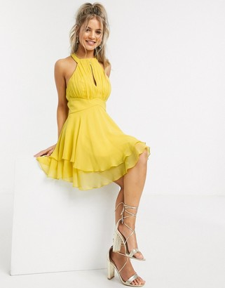 ASOS DESIGN halter pleated mini dress with key hole and soft layered skirt in mustard