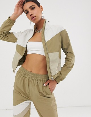 Asos DESIGN cropped tracksuit jacket in khaki colour block
