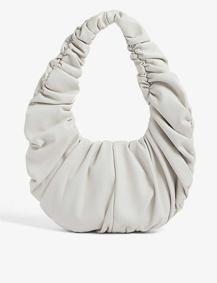 Nanushka Anja ruched faux-leather baguette bag