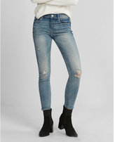 Express mid rise light wash distressed stretch jean leggings
