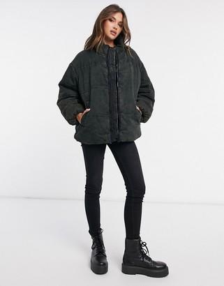 ASOS DESIGN washed canvas puffer jacket in black