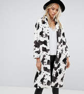 Religion Longline Coat In Cow Print Faux Fur