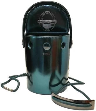 Perrin Paris Turquoise Patent leather Handbags