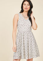 10179573 Quiet moments spent in this ivory dress are superb, but a soundtrack of praise for its black-outlined floral lace, gold-buttoned V-back, and classic silhouette is even better! For low-key fetes and high-energy gatherings alike, like feminine cocktail froc