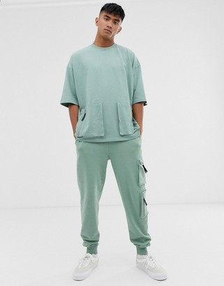 ASOS DESIGN two-piece oversized t-shirt with half sleeve in heavyweight jersey with utility pockets
