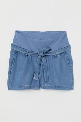 H&M MAMA Lyocell-mix denim shorts