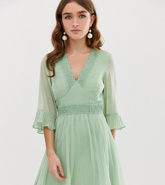 Asos DESIGN Petite pleated mini dress with lace inserts-Green
