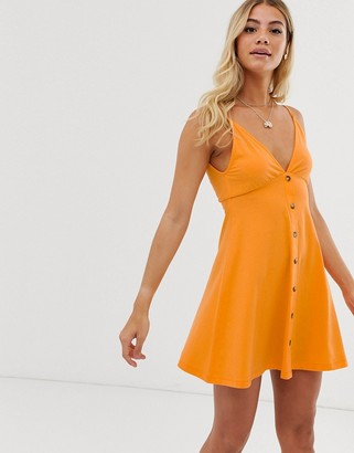 Asos DESIGN cami smock mini sundress with buttons in orange