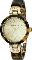 Anne Klein Women's 109652CHTO -Tone Tortoise Plastic Bezel and Bangle Bracelet Watch
