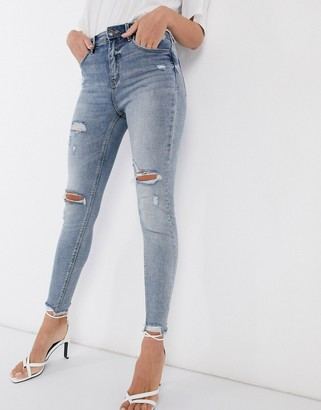 Stradivarius high waist skinny jeans with rips in medium wash