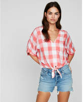 Express gingham short sleeve tie front shirt