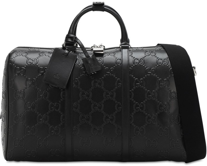Gucci Gg Debossed Leather Duffle Bag