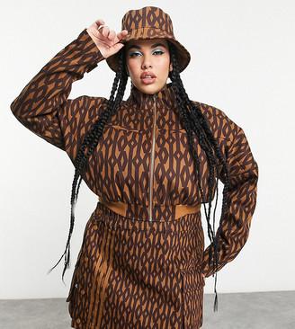Ivy Park adidas x Plus monogram mini skirt in wild brown