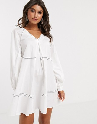 Asos Design DESIGN mini smock dress with long sleeves and contrast stitching-White