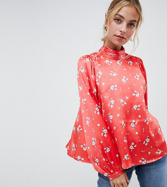 Asos DESIGN Petite satin long sleeve blouse with high neck and open back in floral print
