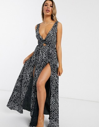 ASOS DESIGN tie back beach maxi dress with twist front detail in black mono spot print