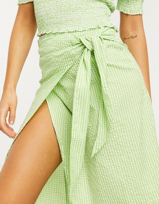 Monki Gab check print wrap midi skirt in green