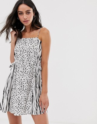 ASOS DESIGN mini cami sundress with drawstring waist in mixed animal print