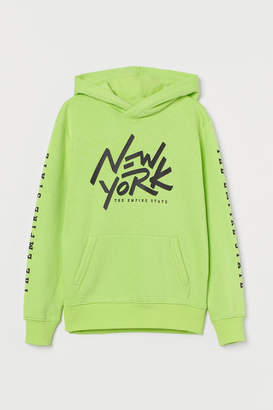H&M Hooded top with a motif