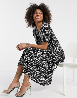 Asos DESIGN plisse midi dress with tie waist in black and white spot