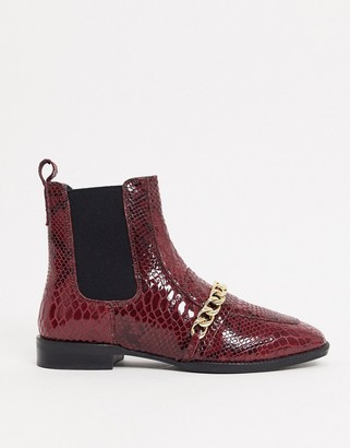 ASOS DESIGN Ava leather loafer boot with chain trim in red snake