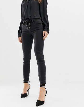 Asos Design DESIGN Whitby low rise skinny jeans in washed black with lace up front detail