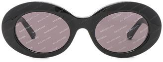 Balenciaga Oval Logomania Sunglasses in Black & Smoke   FWRD