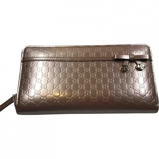 Gucci Metallic Leather Wallets