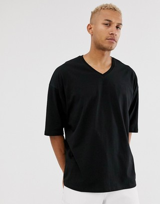 Asos DESIGN oversized t-shirt with v neck and seam detail in black