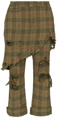 R 13 distressed skirt-detail checked trousers
