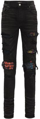 Amiri MX1 patch distressed slim-leg jeans