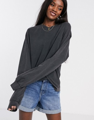 ASOS DESIGN oversized long sleeve t-shirt with cuff detail in washed black