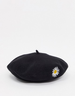 ASOS DESIGN wool beret with daisy embroidery in black