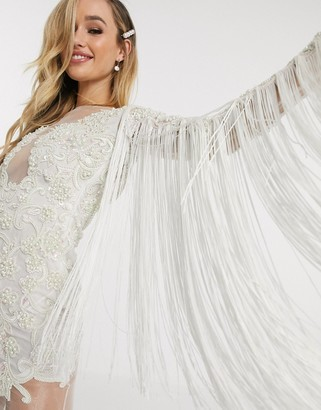 A Star Is Born bridal dress with fringed sleeves and attached bodice in white