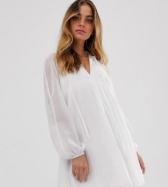 Asos DESIGN Petite pleated trapeze mini dress with tie neck-White