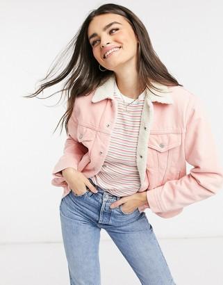 Levi's ex-boyfriend Sherpa trucker denim jacket in pink