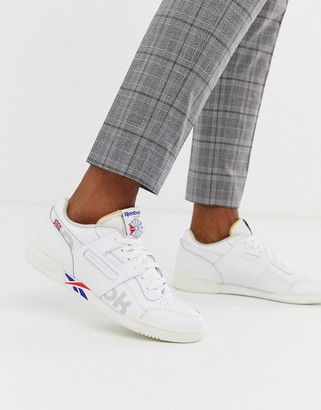 Reebok Workout Plus Mu trainers with vector branding in white