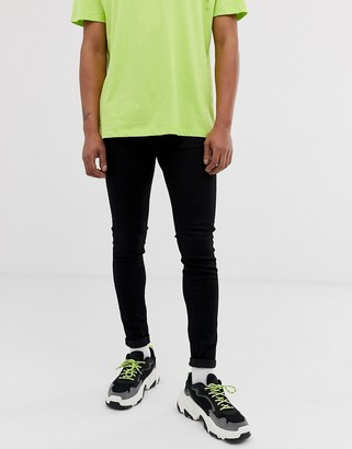 Cheap Monday him spray super skinny jeans in black