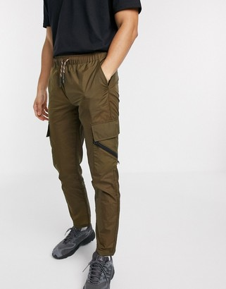 Asos DESIGN slim trousers in nylon with elastic waist and contrast trims