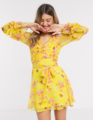 Asos DESIGN mini dress with layered skirt and wrap waist with lace trim detail in yellow floral print