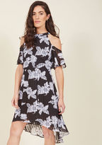 36383 If you don't debut this black cocktail frock at the upcoming fete, how will anyone know you own such a stunning look? Make your elegance apparent by arriving in the cold shoulders, shadowy stripes, and subtle high-low hem of this floral frock, because an