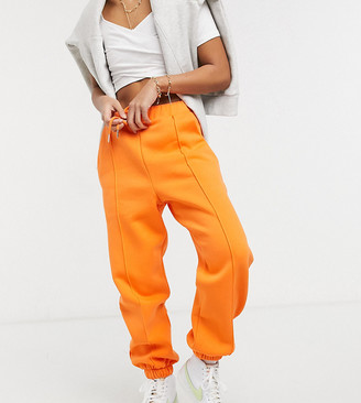 ASOS DESIGN Petite oversized trackies with pintuck in orange