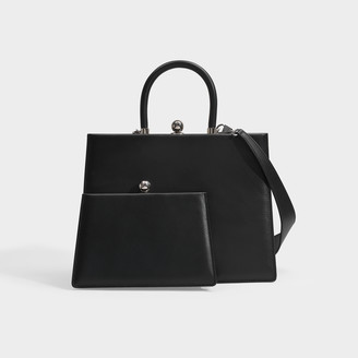 Most Wanted Design by Carlos Souza Ratio Et Motus Twin Frame Top Handle Bag