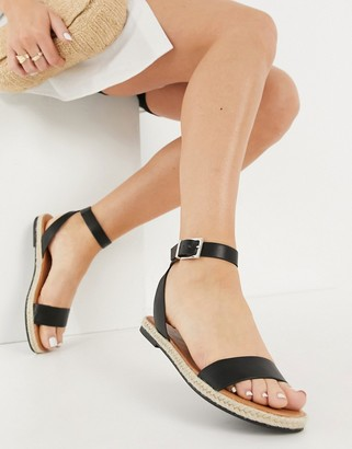 Call it SPRING redlip two-part flat sandals in black
